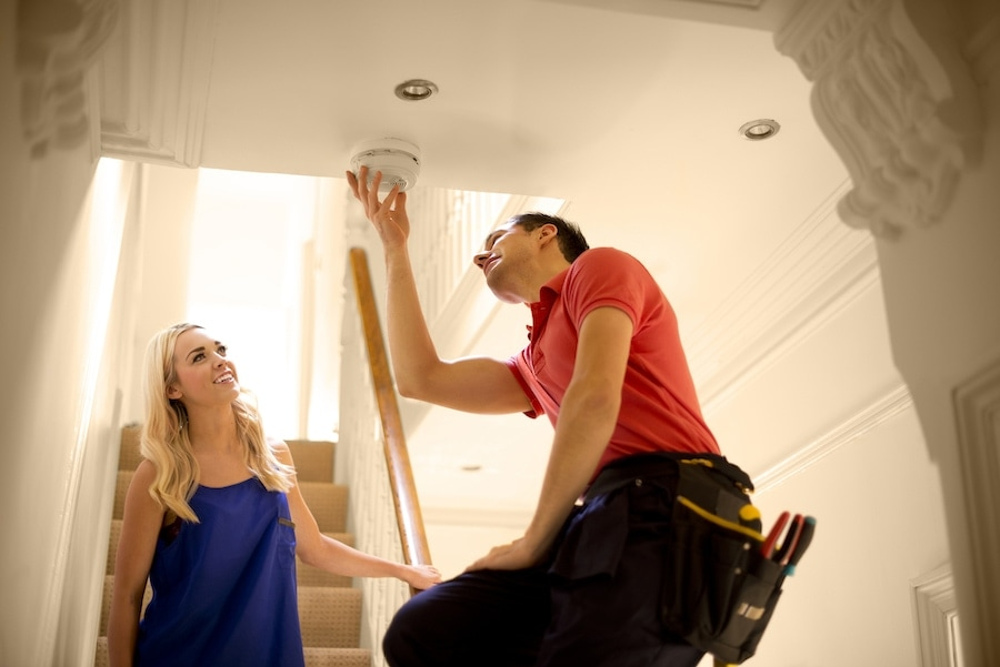 HVAC technician installing a carbon monoxide detector in Petal
