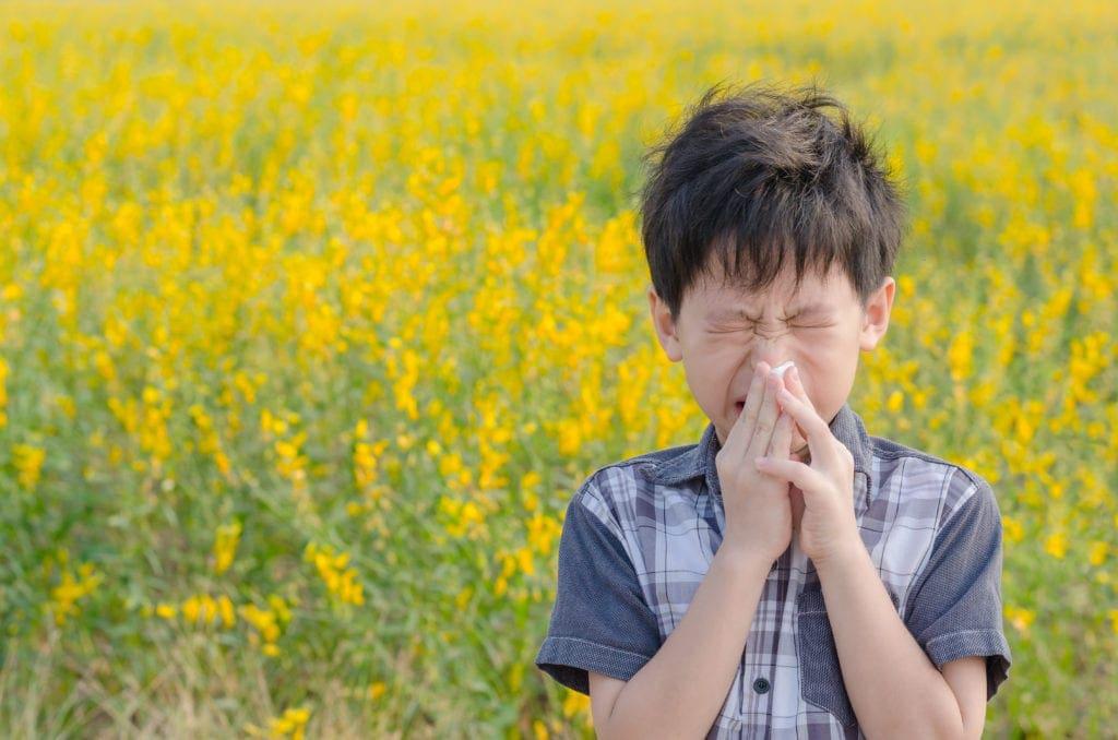 Kid blowing nose